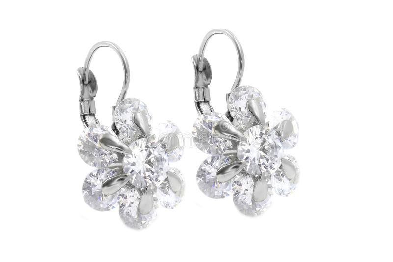 Jewelry earrings. Stainless steel with zircons stock photos