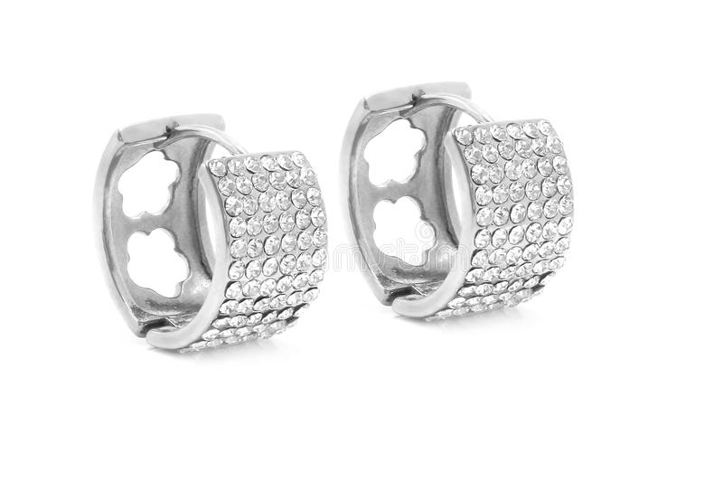Jewelry earrings. Stainless steel with zircons royalty free stock photos
