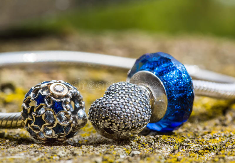 Jewelry, female bracelet. Jewelry bracelet women on an old wooden surface, modern fashion, charms, jewelry, macro royalty free stock photo