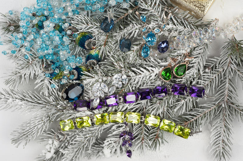 Jewelry at fir tree. Jewelry with gems at fir tree stock photo