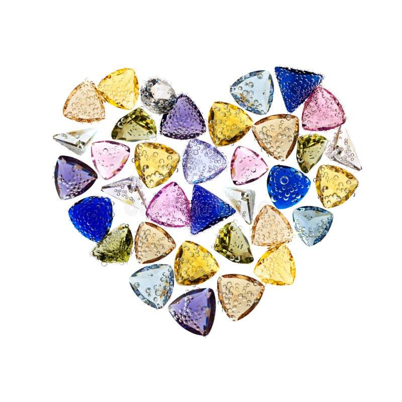 Jewelry gemstones heart shaped. Isolated on white. royalty free stock image