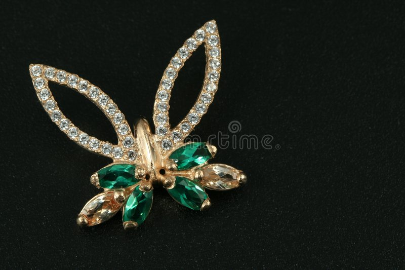 Jewelry gift. butterfly. Jewelry gift. brooch with emerald & brilliants royalty free stock images