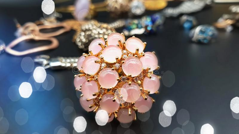 Jewelry gold earring rings   opal crystal pearl necklace bracelets for women girl wedding and gift hand watch in cosmetic cases ac. Beautiful jewelry pink opal royalty free stock image