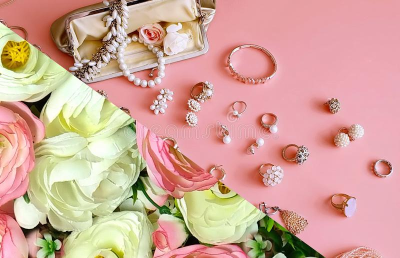 Jewelry white pearl fashion  cosmetics cases luxury  rings earrings bracelet gold on pink Women accessories costume Coral stylish. Jewelry gold white pearl trend stock photography