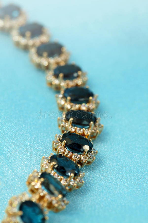 Jewelry golden bracelet. Jewelry accessories - bracelet with sapphire and brilliants royalty free stock image