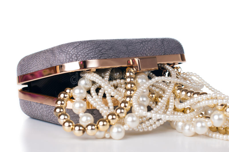 Jewelry in handbag royalty free stock photography