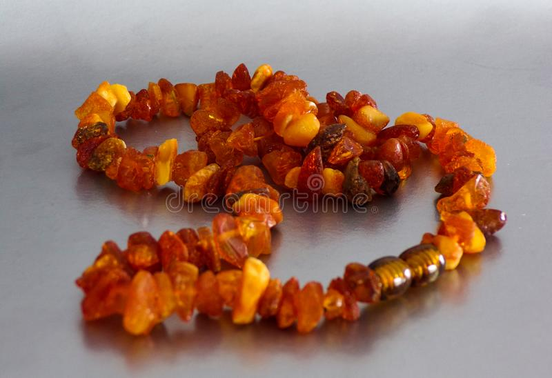 Jewelry made of amber stone. stock photos
