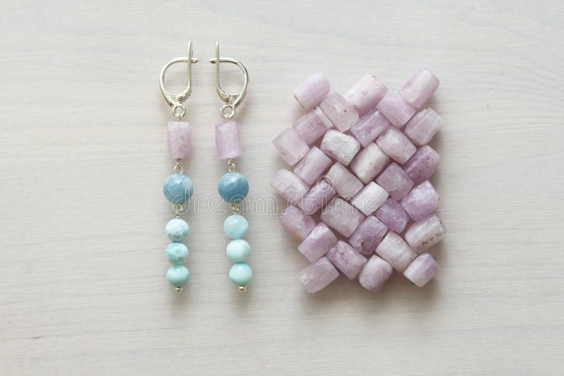 Jewelry made of natural stones and silver. Aquamarine, larimar, kunzite, moonstone. Handmade. Earrings made of natural stones royalty free stock images