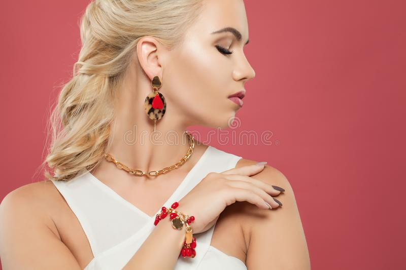 Jewelry model. Elegant woman with golden chain necklace, earrings and bracelet.  stock photos