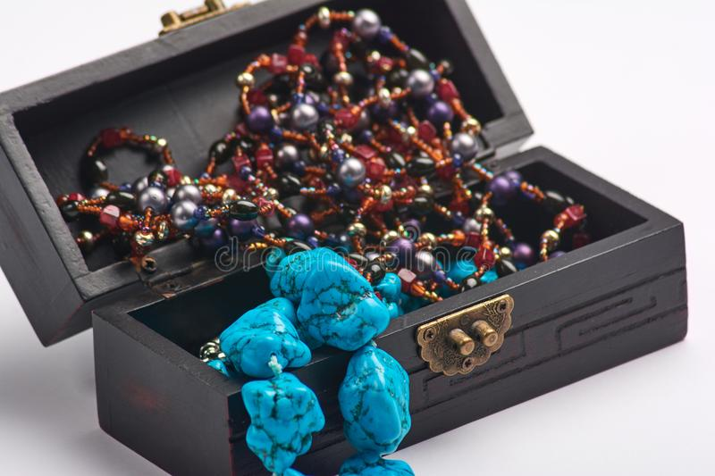 Jewelry old box and blue bead necklace. Isolated on a white background. royalty free stock images