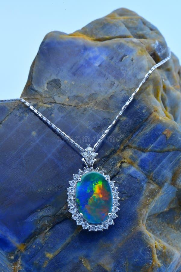Sri Lankan gem - Opal with Diamond Pendent. Jewelry - Opal with Diamond pendent on Blue Sapphire Rough Stone stock photos