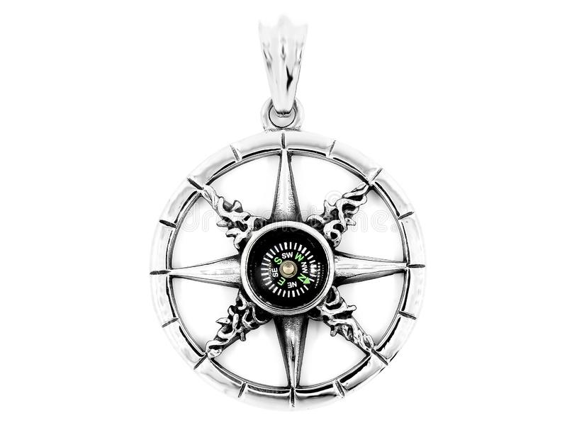 Jewelry pendants. Rudder. Compass. Stainless steel stock image