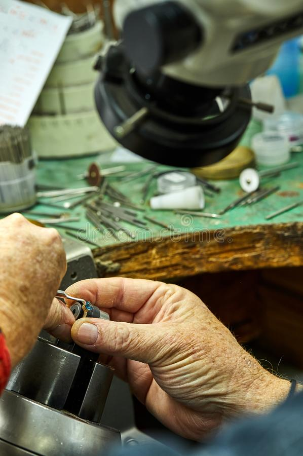 Jewelry production. The process of fixing stones stock images