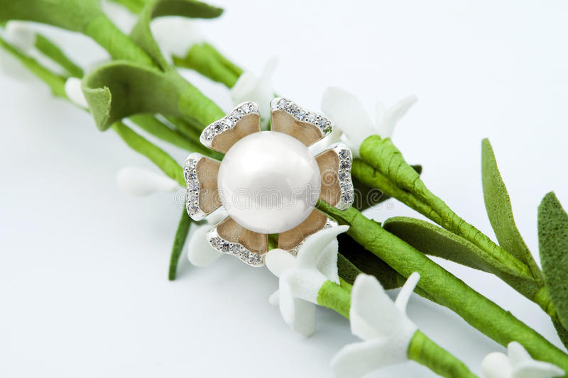 Jewelry ring with pearl and flowers. Elegant female jewelry ring with pearl and flowers stock photo