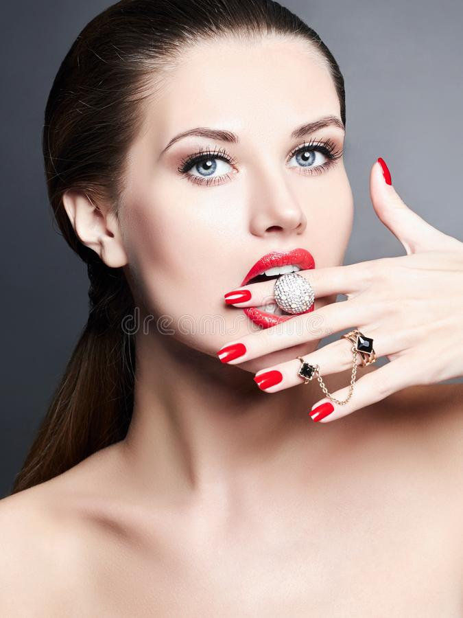Jewelry rings. beauty girl with make-up and manicure royalty free stock images