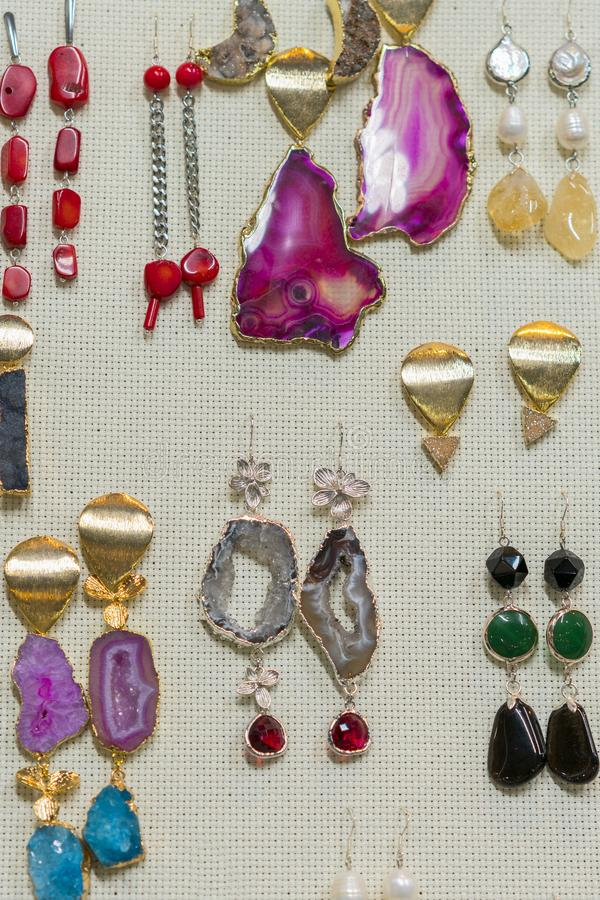 jewelry from semi-precious stones. Earrings with stones. vertical photo stock photography