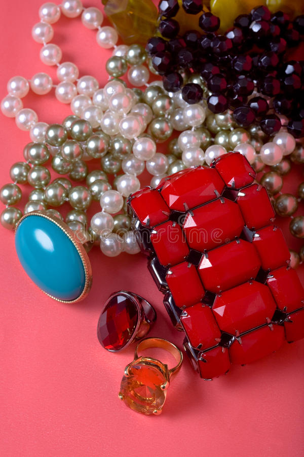Jewelry set. On red background. macro royalty free stock photo