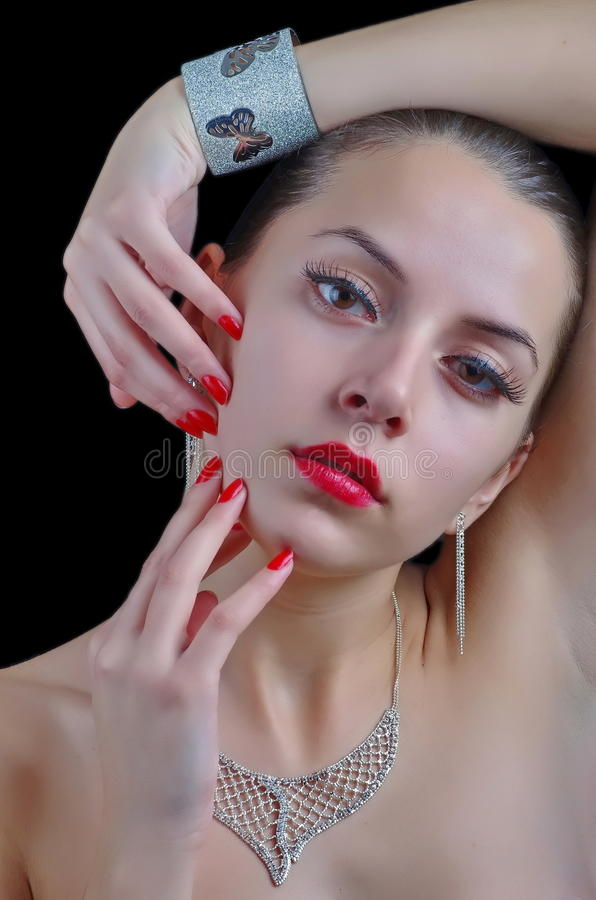 Jewelry Styled Photo shoot. Beautiful Fashion woman model posing with fashion chic jewelry on black background. Studio shot stock image