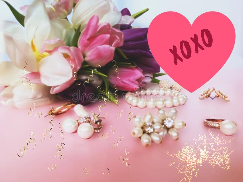 Red Heart on jewelry white pearl and  floral  pink background  ,spring flowers for Valentine day, Women day  ,Wedding  background royalty free stock image