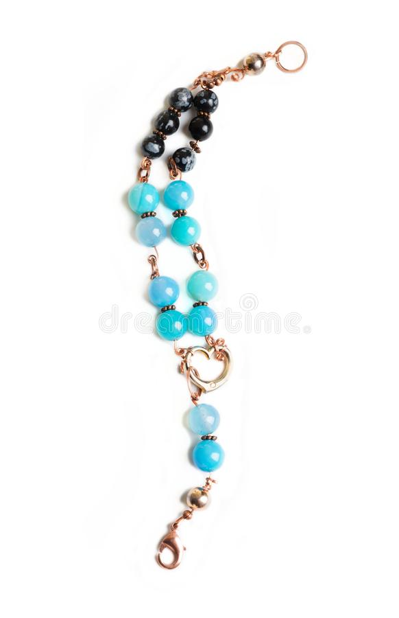Jewerly bracelet with chalcedony and obsidian around white back. Ground royalty free stock photo