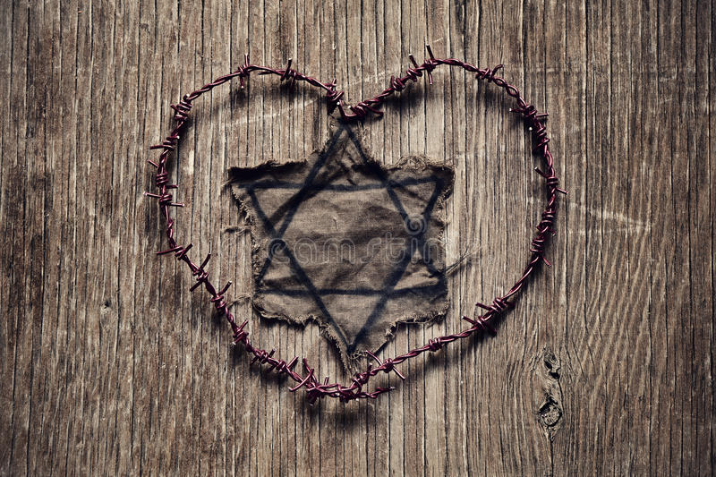 Jewish badge and barbed wire forming a heart royalty free stock photography