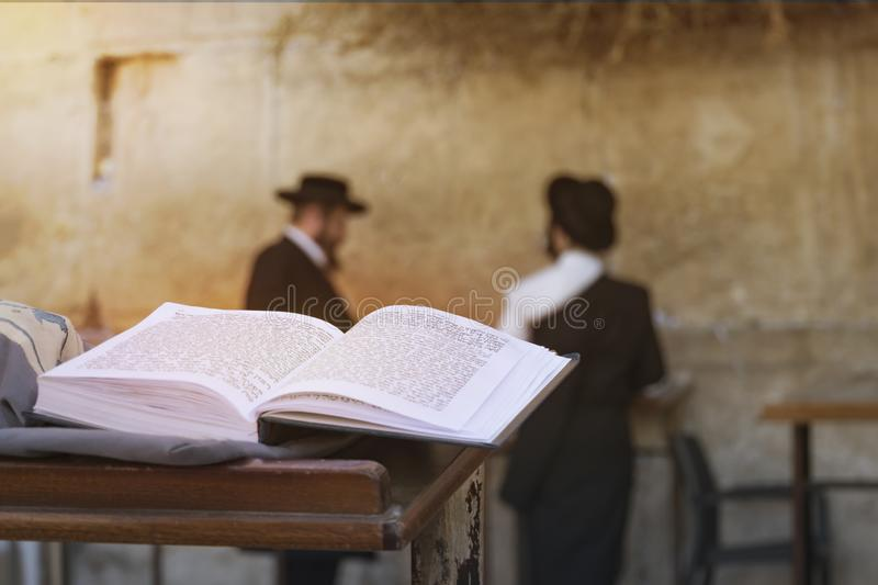 Jewish bible on table, wailing western wall, jerusalem, israel. book of the Torah-the Pentateuch of Moses is open on the prayer royalty free stock images