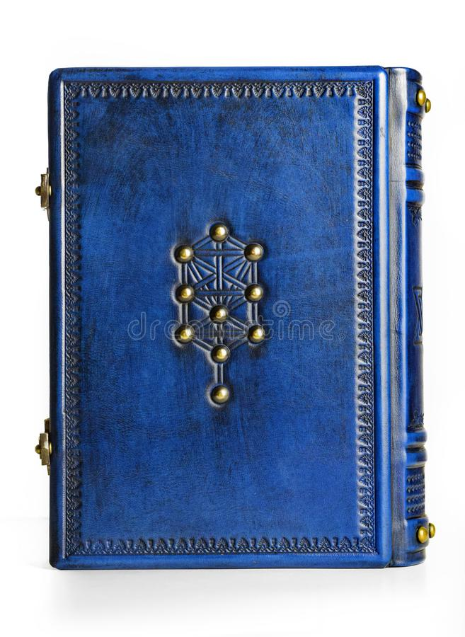 Jewish blue leather book with the tree of life symbol on the front cover and right to left reading royalty free stock photo