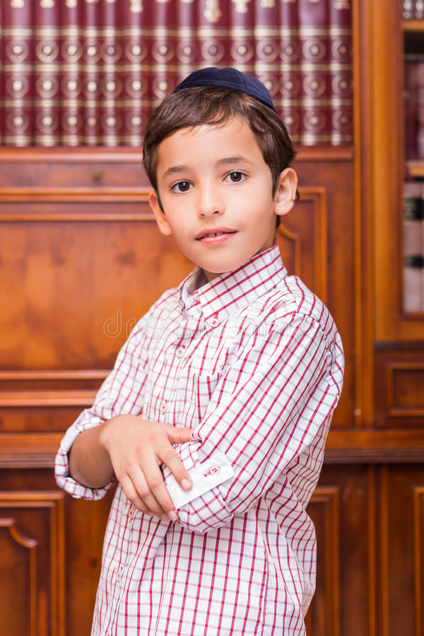 Jewish boy with a black yarmulke, kippa in Hebrew. Beautiful Jewish boy with a black yarmulke, kippa in Hebrew royalty free stock image