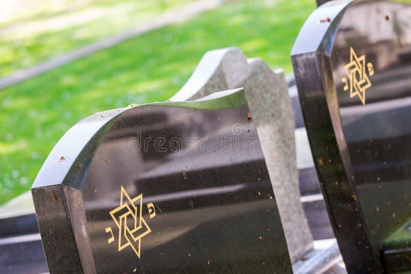 Jewish cemetery: Star of David on the tombstone. Jewish cemetery: closeup on Star of David on the tombstone stock photos