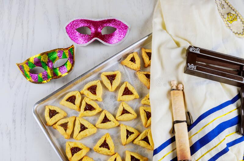 Jewish cookies for Purim with mask, tallit and noisemaker stock photos
