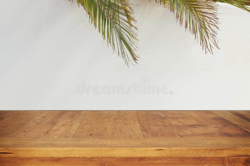Jewish festival of Sukkot. Traditional succah & x28;hut& x29;. Empty wooden old table for product display and presentation.  royalty free stock image