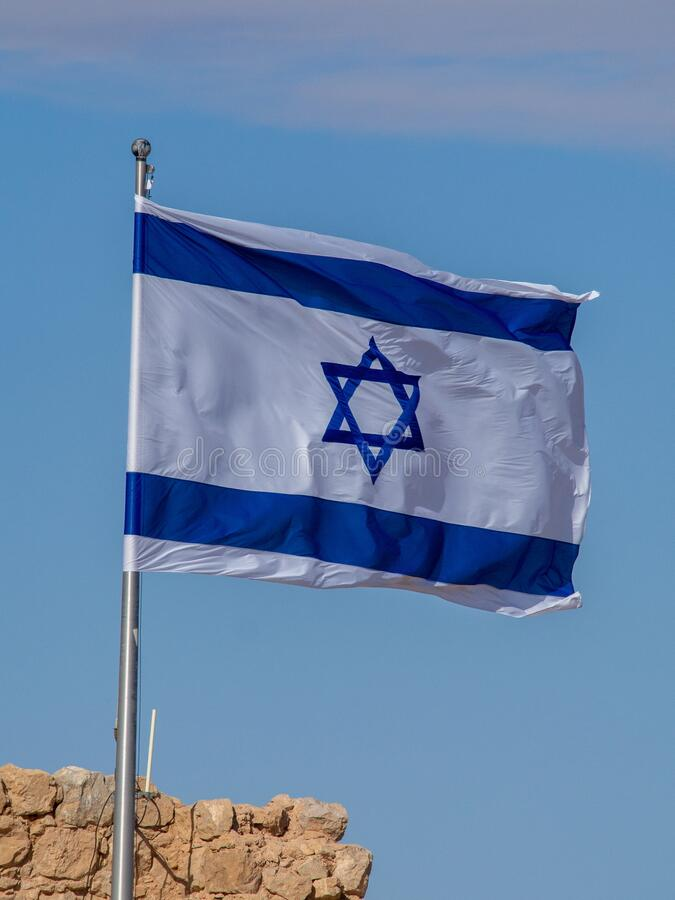 Jewish flag on top of the Masada fortress royalty free stock photography