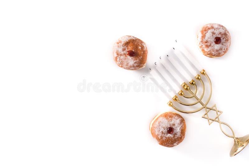 Jewish Hanukkah menorah and sufganiyot donuts isolated on white background royalty free stock image