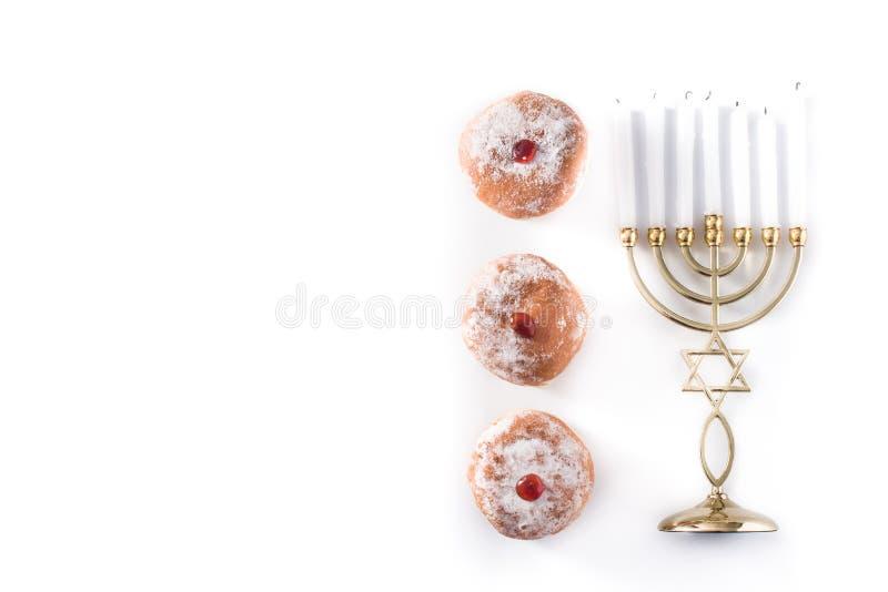 Jewish Hanukkah menorah and sufganiyot donuts isolated on white background stock photo