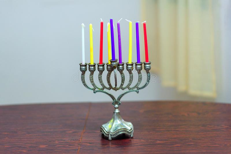 Jewish holiday Hanukkah background with menorah and colorful candles. stock photos