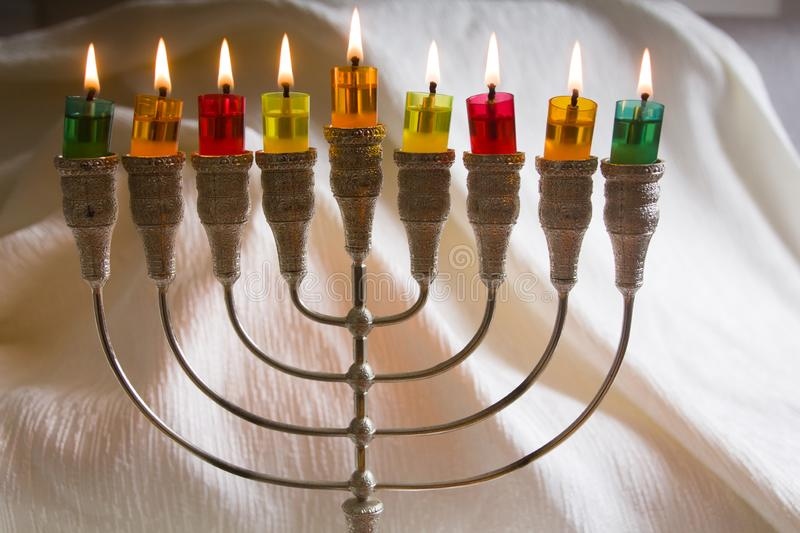 Jewish holiday Hanukkah symbol - The Menorah traditional candelabra and burning candles. Jewish holiday Hanukkah background with Menorah traditional candelabra royalty free stock photo