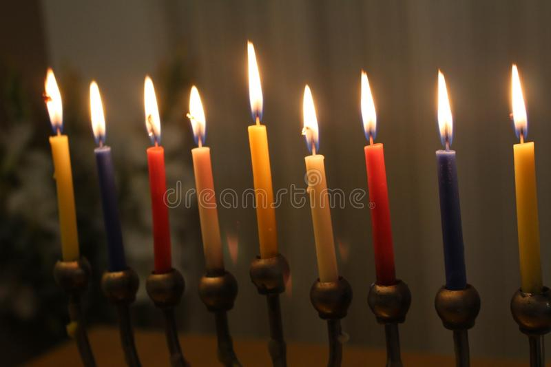 Jewish Holiday Hanukkah Candles Light In Menorah With Red, Blue, White And  Yellow Colors