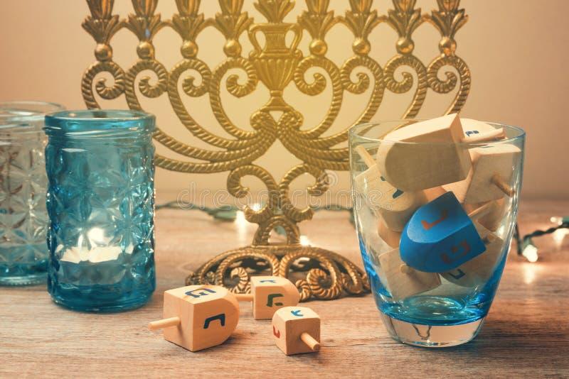 Jewish holiday Hanukkah celebration with spinning top dreidel. Retro filter effect. stock photos