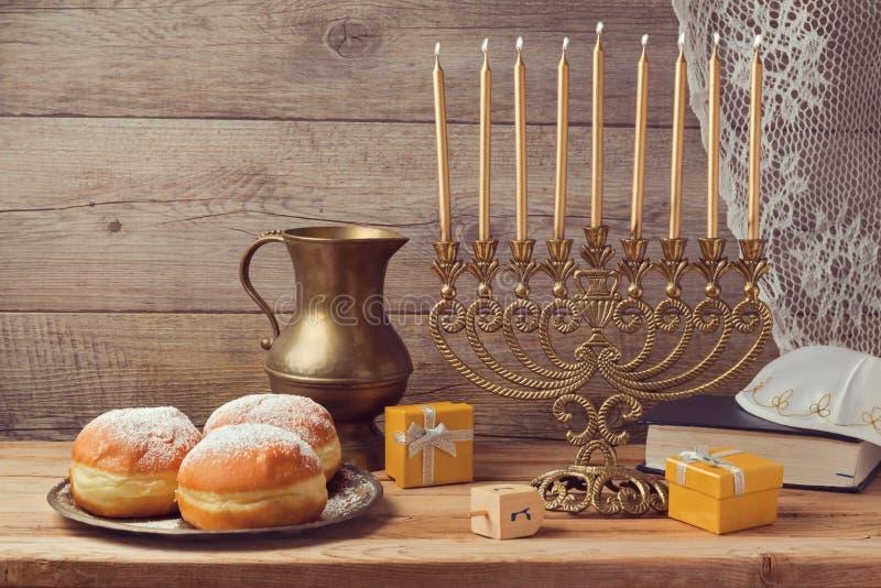 Jewish holiday Hanukkah celebration with vintage menorah royalty free stock image
