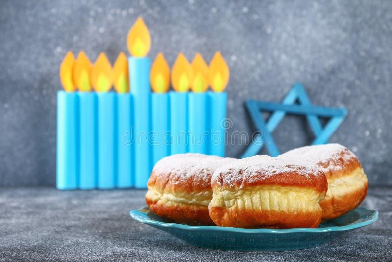 Jewish holiday Hanukkah and its attributes, menorah, donuts, Star of David. Hanukkah menorah. Hanukkah holiday. Jewish Hanukkah. royalty free stock photo