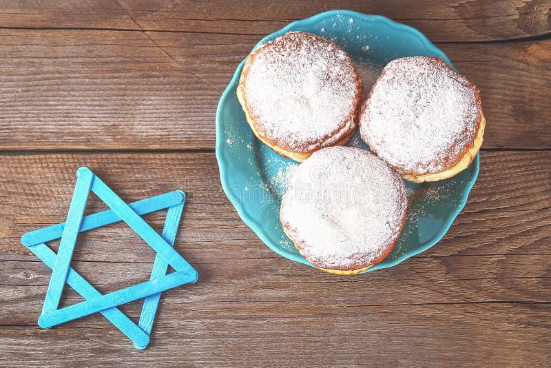 Jewish holiday Hanukkah and its attributes, menorah, donuts, Star of David. Hanukkah menorah. Hanukkah holiday. Jewish Hanukkah. stock images