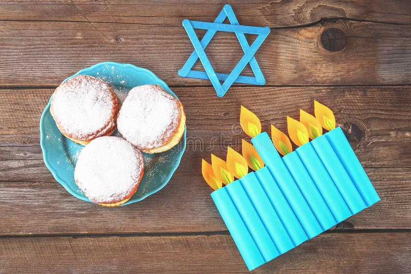 Jewish holiday Hanukkah and its attributes, menorah, donuts, Star of David. Hanukkah menorah. Hanukkah holiday. Jewish Hanukkah. stock image