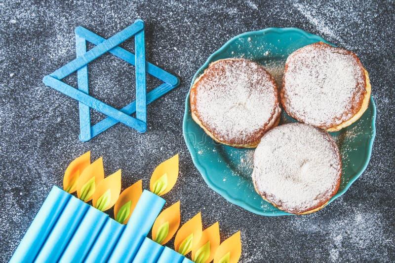 Jewish holiday Hanukkah and its attributes, menorah, donuts, Star of David. stock photos