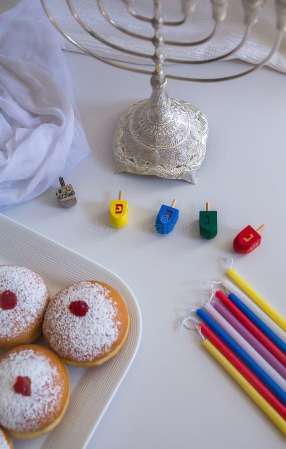Jewish holiday Hanukkah symbols against white background royalty free stock photo