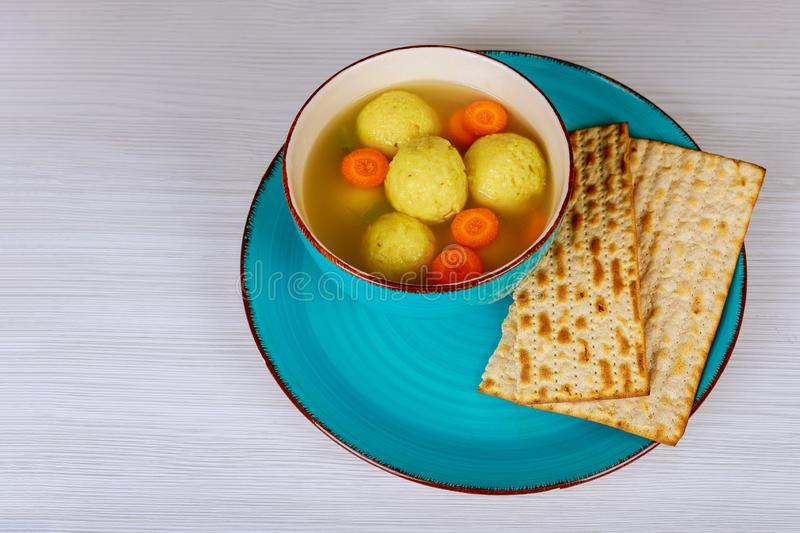 Jewish Holiday kosher food served on passover matzah ball soup in a pot stock image