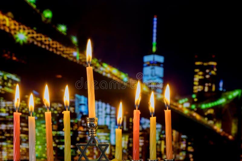 Brightly Glowing Hanukkah Menorah Shallow Depth of Field Brooklyn Bridge over night stock photos