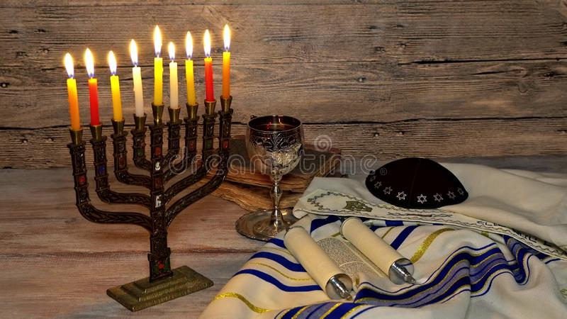 Jewish holiday, Holiday symbol Hanukkah Brightly Glowing Hanukkah Menorah. Shallow Depth of Field stock photo