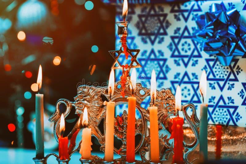 Brightly Glowing Hanukkah Menorah soft focus stock image