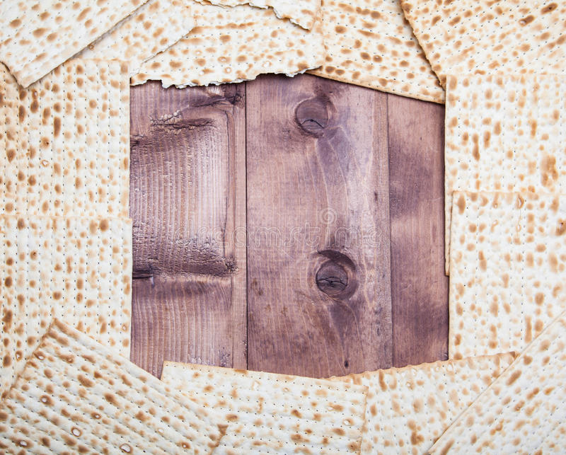 Jewish holiday Passover background. Matza on wooden table with c royalty free stock image