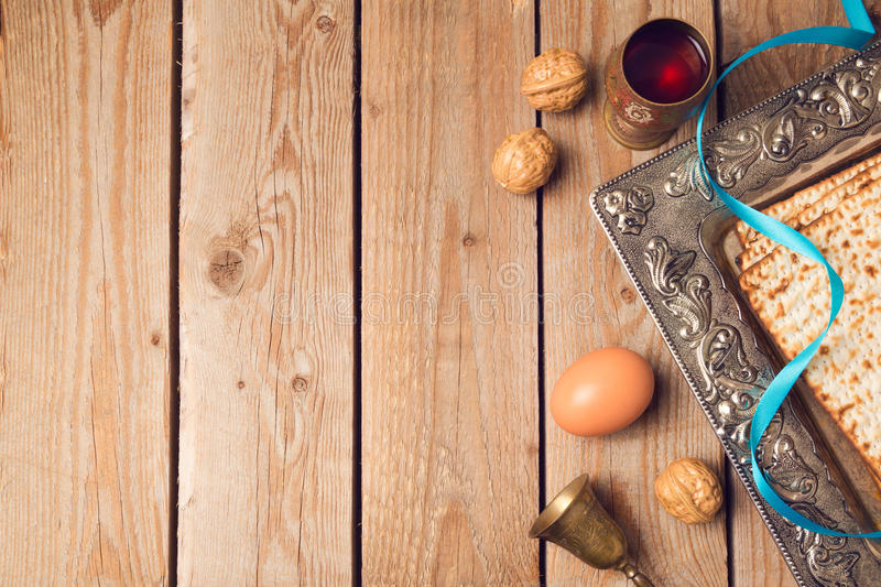 Jewish holiday Passover concept with matzah, seder plate and wine on wooden background. View from above stock photos
